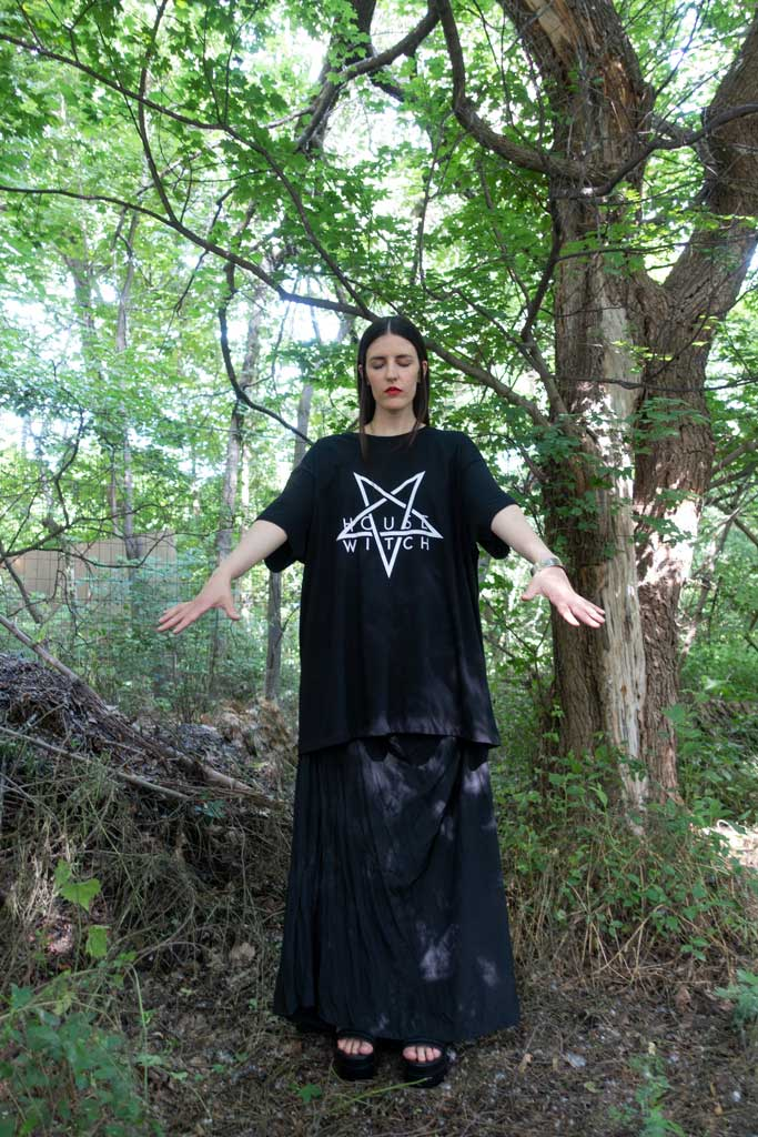 Woman standing amidst trees conjuring a spirit wearing Witch House, a black 4XL T-Shirt by House of the House.